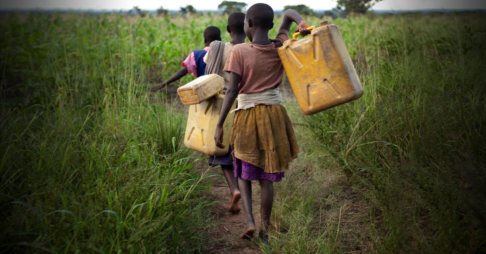 Girls walking to the river.
