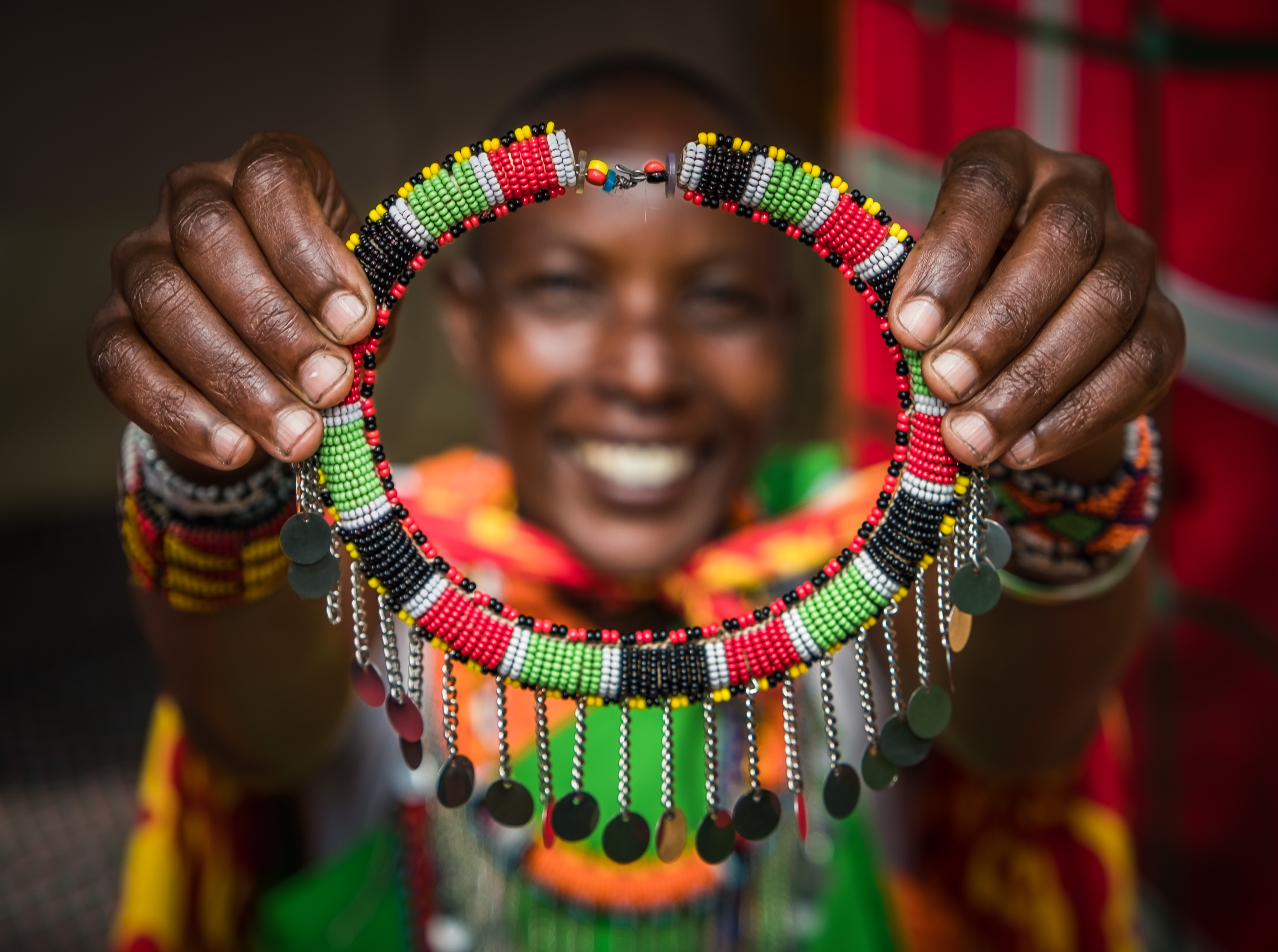 Woman holding up beads